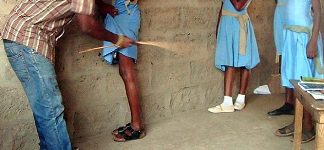 Teacher flogging student