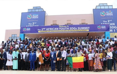 A group photo of the opening panel and conference attendees at the Accra International Conference Centre