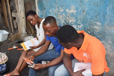 Youth Fellows distributing flyers to Residents