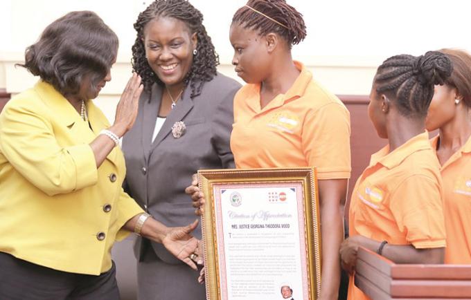 Kakayei presenting thier citation to the  CJ