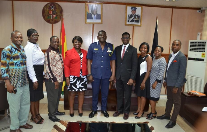 Mr David Asante Apeatu IGP and Mr Miyi Ojuolape UNFPA Representative in a group photo with staff from both institutions