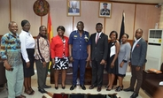 Mr David Asante Apeatu IGP and Mr Miyi Ojuolape UNFPA Representative in a group photo with staff from both institutions